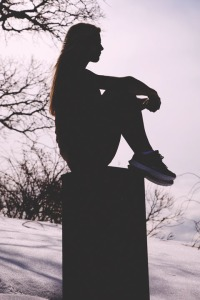 woman sit on block silhouette