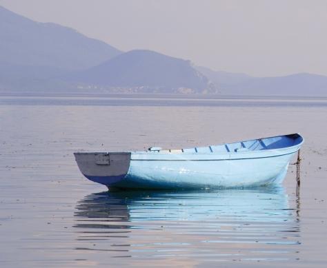 A rowboat on a peaceful lake